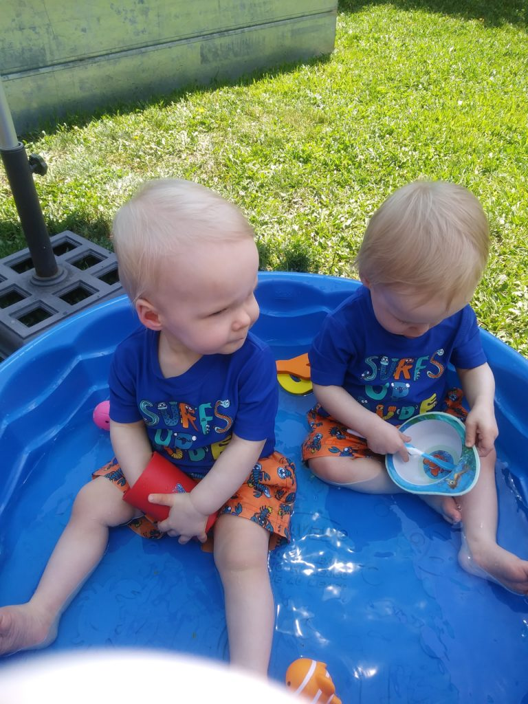 The Twins playing in their kiddie pool