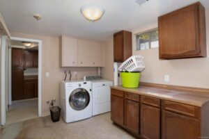 Before photo of the laundry room/kitchenette.