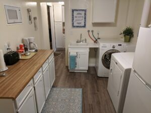 After photo of the laundry room/kitchenette.